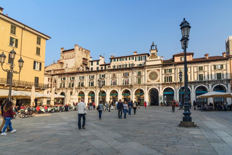 Il dell ?Orologio di Torre ? torre di orologio sulla loggia quadrata di della piazza a Brescia L'Italia fotografia stock libera da diritti