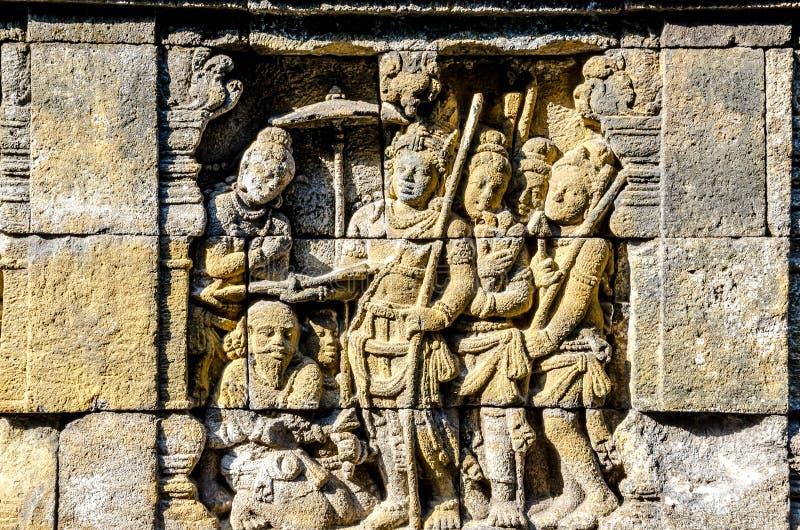 Il dettaglio del buddista ha scolpito il sollievo in tempio di Borobudur in Yogyakar fotografie stock