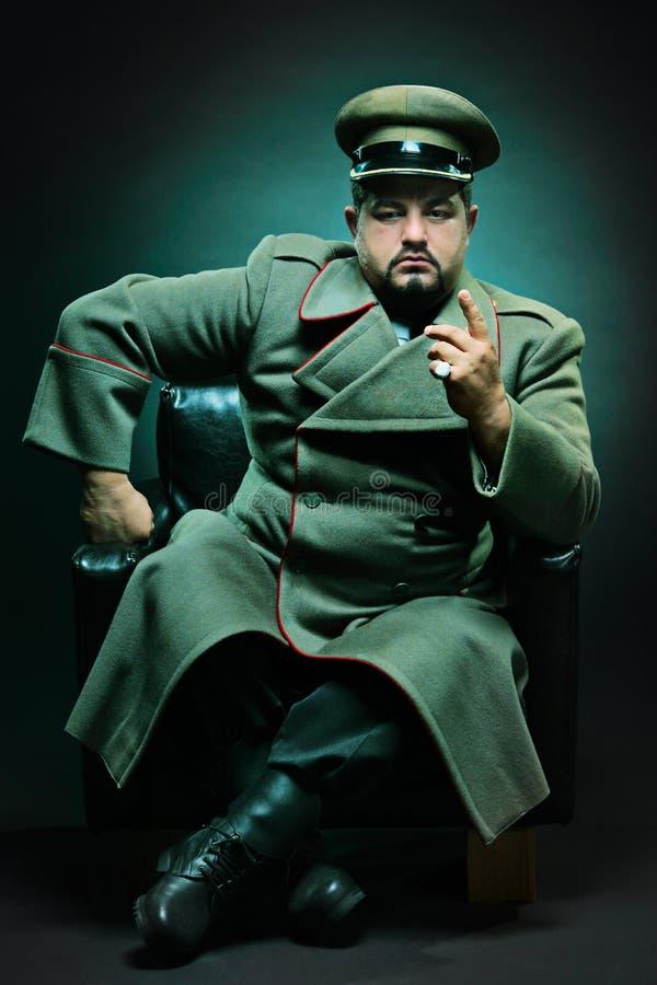Download Il dictator diabolico fotografia stock. Immagine di rivestimento - 7302638