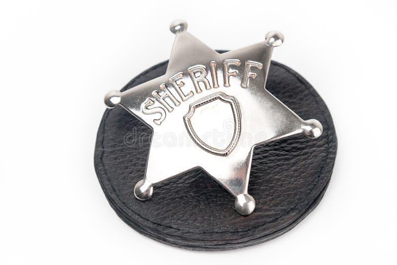 Il distintivo dello sceriffo isolato su bianco fotografie stock libere da diritti