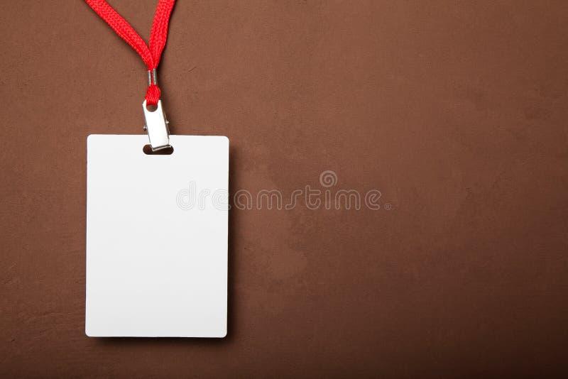 Il distintivo di plastica del modello della carta di identificazione dello spazio in bianco svuota falso su fotografia stock