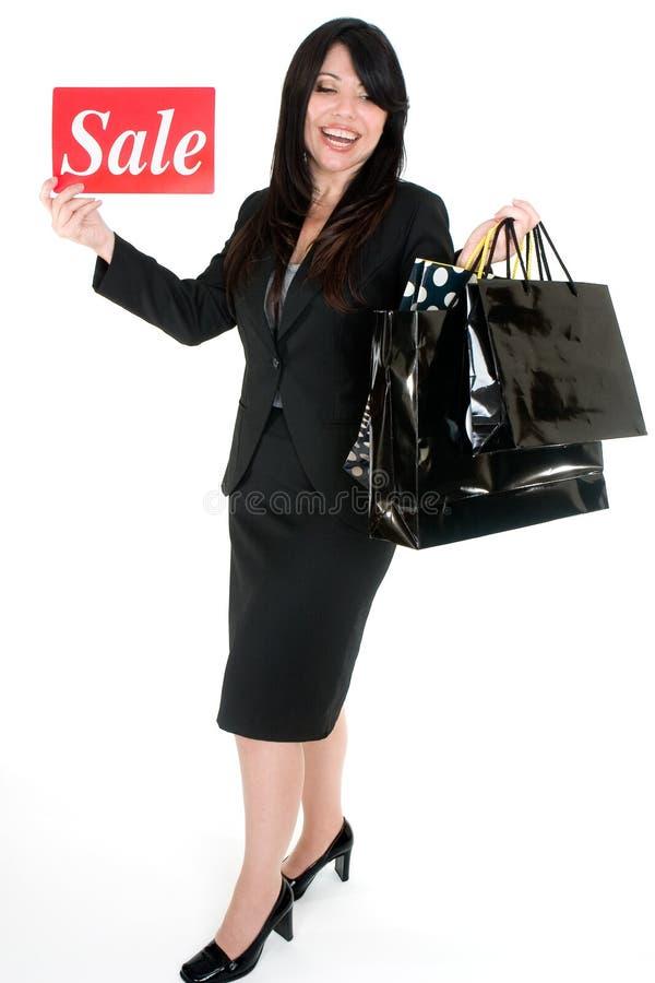 Il est temps de vente - femme avec des sacs à provisions image libre de droits