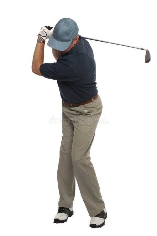 Il ferro del giocatore di golf sparato indietro oscilla fotografie stock libere da diritti