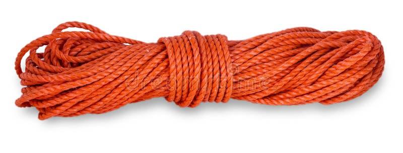 Il filo della corda rossa con rotola su su un fondo bianco fotografia stock