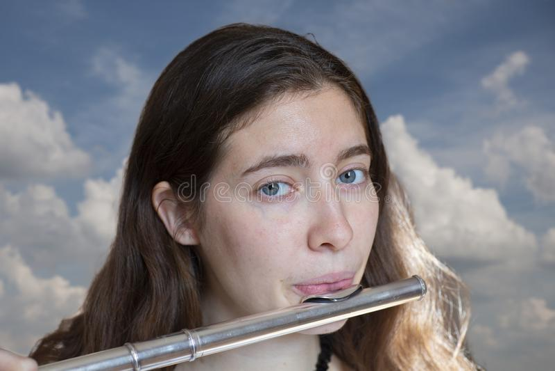 Il flautista Girl Flute Player del musicista immagine stock libera da diritti