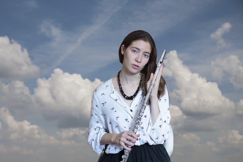 Il flautista Girl Flute Player del musicista fotografie stock