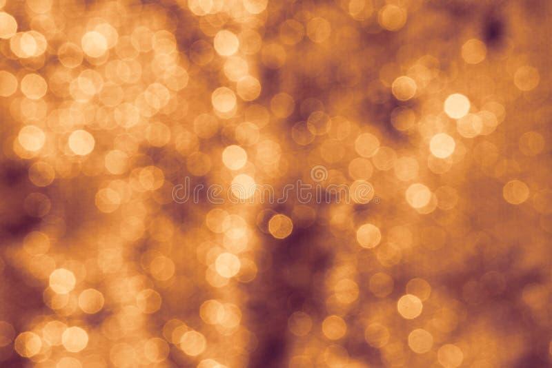 Il fondo accende l'arancia astratta di Bokeh fotografia stock libera da diritti