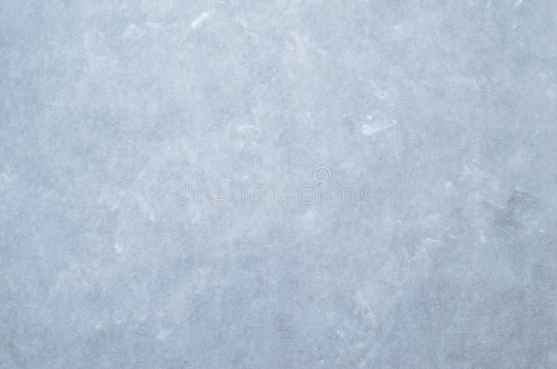 Il fondo astratto blu-chiaro della parete, cementa la struttura concreta dello stucco fotografia stock libera da diritti