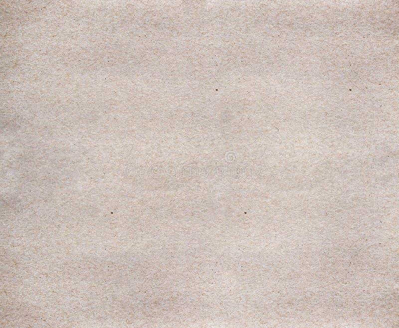 Il fondo beige e marrone è appoggiato da cartone, carta riciclata fotografia stock