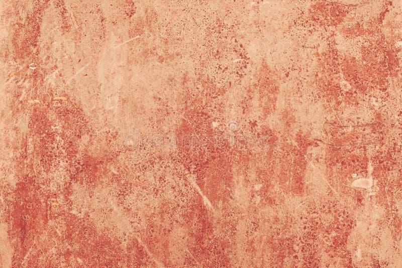 Il fondo concreto della pittura di colore rosso ha dipinto la struttura della parete immagini stock
