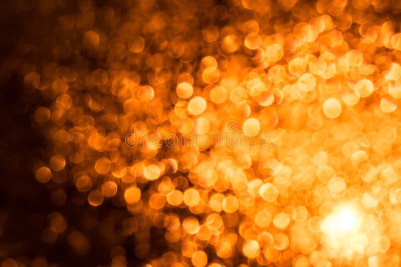 Il fondo dell'astrazione con fuoco giallo arancione si svasa cerchi Fondo di astrazione di Natale con i cerchi fotografia stock libera da diritti
