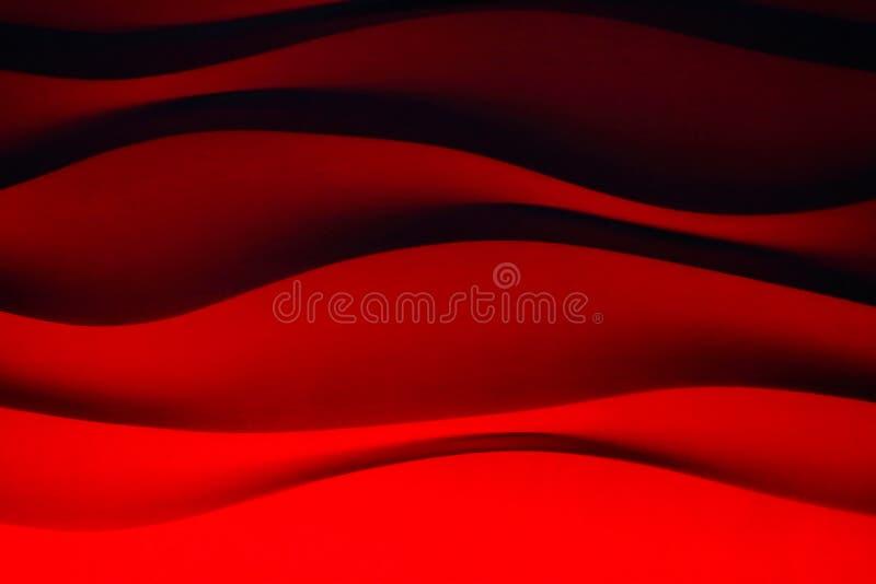 Il fondo della parete ondeggia rosso fotografia stock libera da diritti