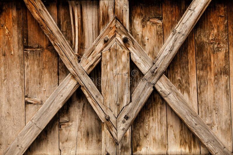 Il fondo di legno con l'oggetto d'antiquariato presenta la progettazione geometrica immagini stock libere da diritti