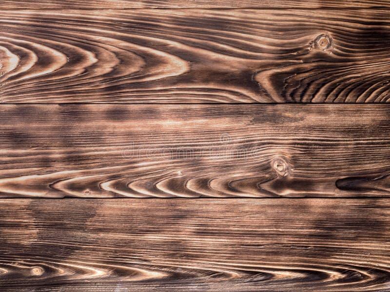 Il fondo di legno dal pino di legno ha bruciato la struttura dell'estratto del pennello fotografia stock