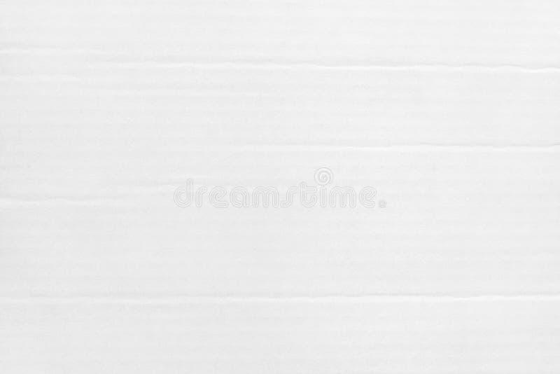 Il fondo grigio bianco dell'estratto dello strato del cartone, struttura di ricicla il contenitore di carta nel vecchio modello d fotografie stock libere da diritti