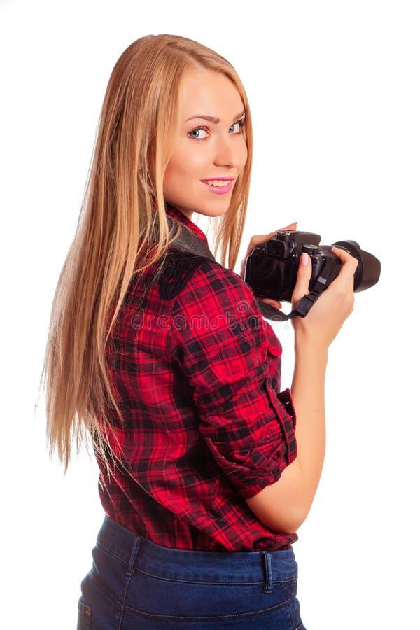 Il fotografo della donna gira intorno mentre spara - isolato su briciolo fotografia stock