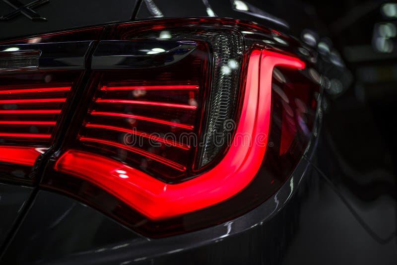 Il frammento di ha acceso le luci posteriori dell'automobile immagine stock