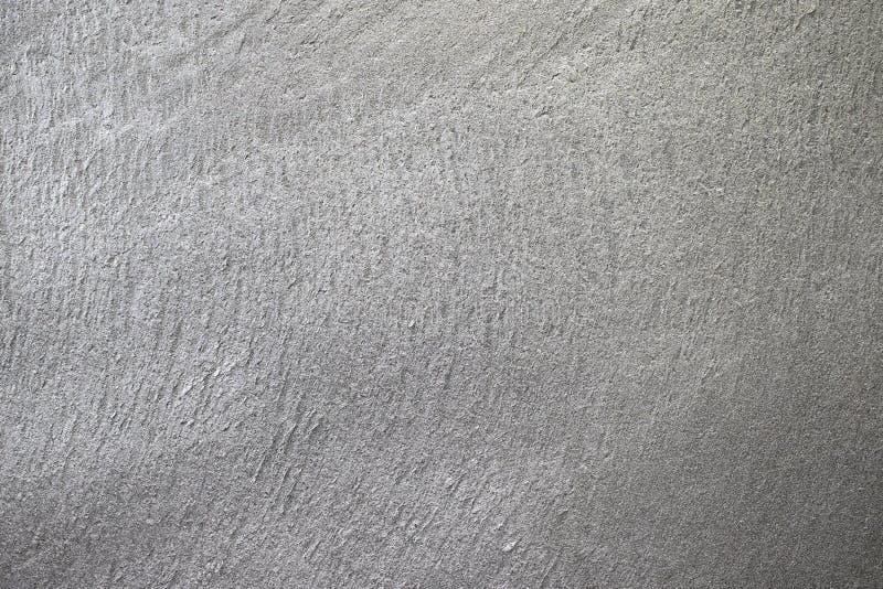 Il gesso strutturato grigio sulla parete è impresso La struttura sulla parete è cuciture ruvide immagine stock libera da diritti