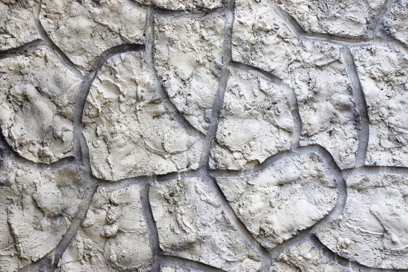 Il gesso strutturato grigio sulla parete ? impresso E immagine stock libera da diritti