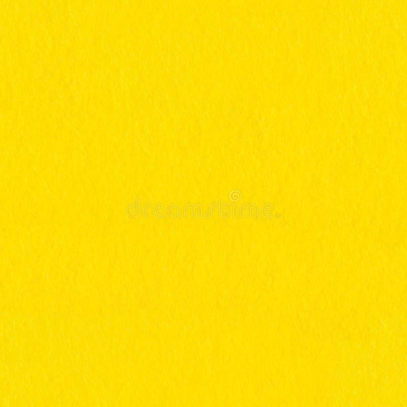 Il giallo ha colorato il feltro, fondo Struttura quadrata senza giunte immagine stock