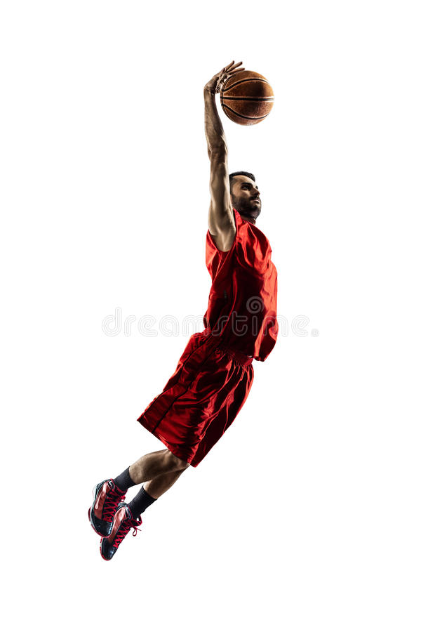 Il giocatore di pallacanestro isolato nell'azione sta volando immagini stock