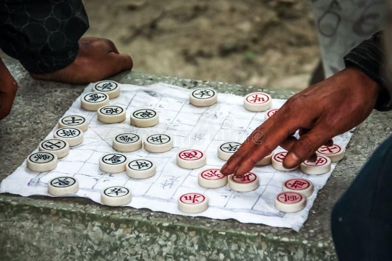 Il gioco di scacchi del cinese tradizionale ha giocato su carta - Shanghai, Cina immagine stock libera da diritti