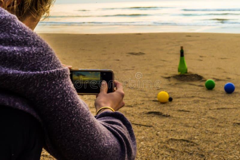 Il gioco sulla spiaggia fotografia stock