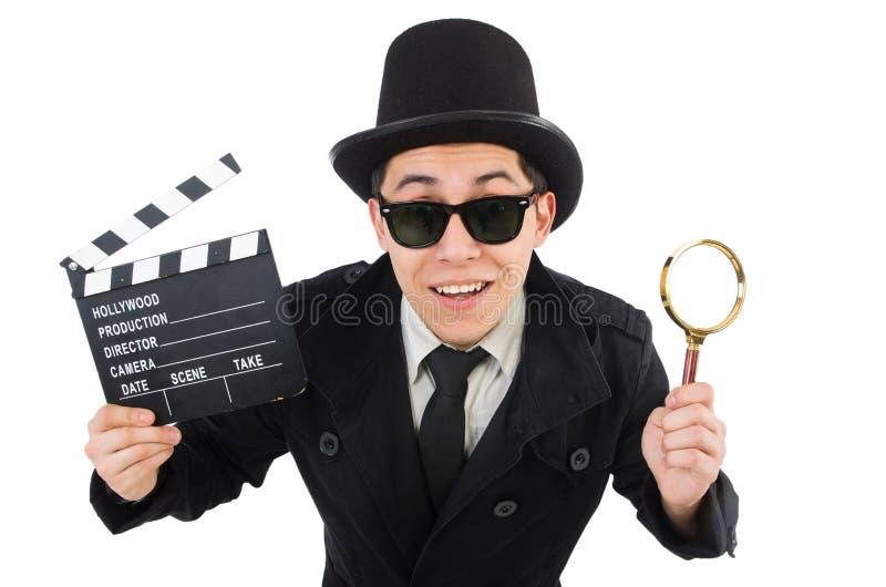 Il giovane agente investigativo con l'assicella e la lente di ingrandimento fotografia stock