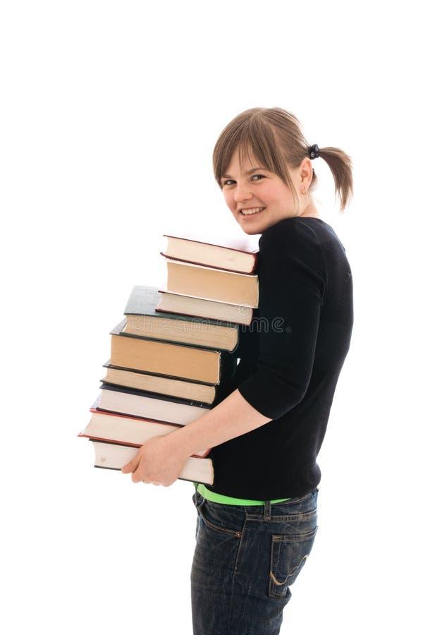 Il giovane allievo felice con i libri isolati fotografie stock