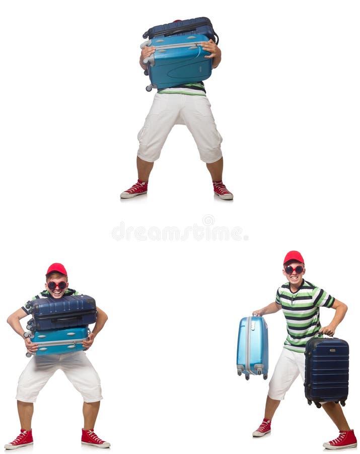Il giovane con le valigie pesanti isolate su bianco immagini stock libere da diritti