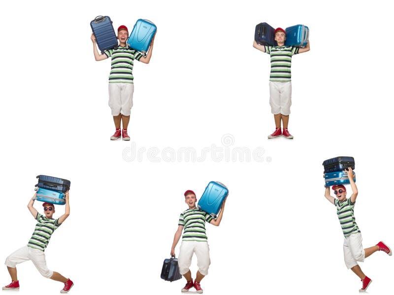 Il giovane con le valigie pesanti isolate su bianco immagini stock