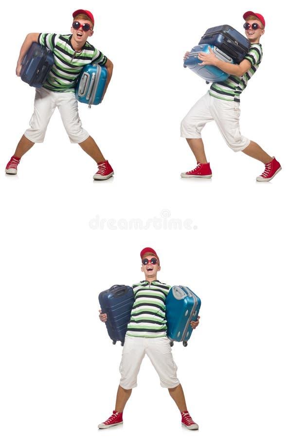 Il giovane con le valigie pesanti isolate su bianco fotografia stock libera da diritti