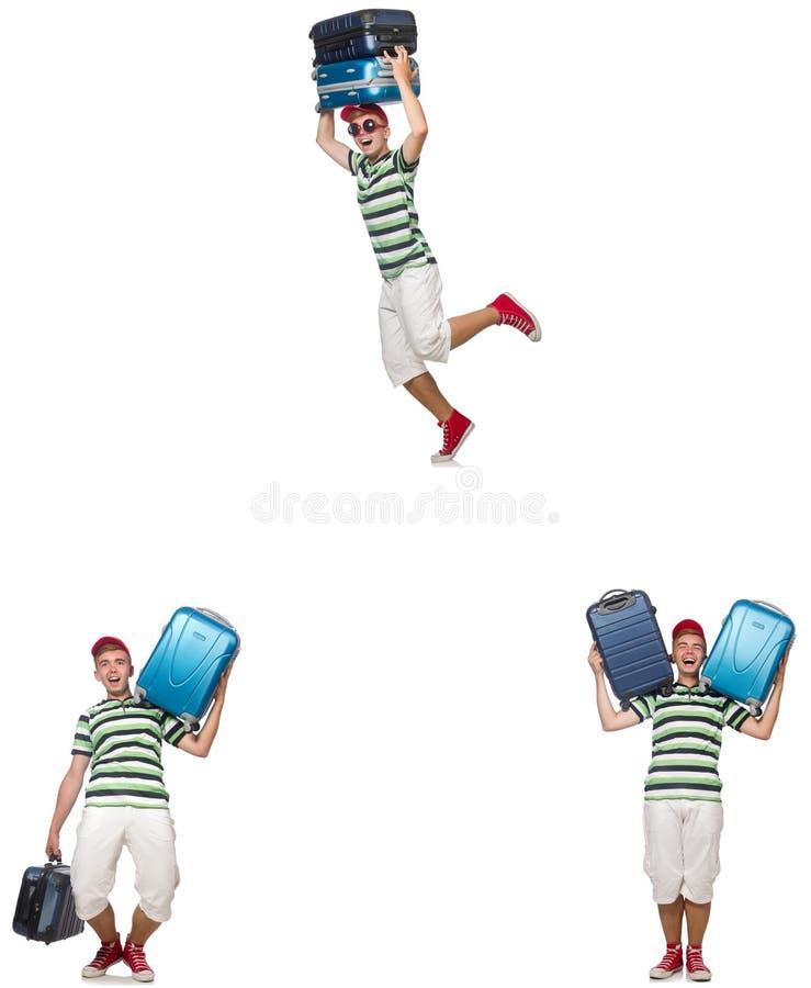 Il giovane con le valigie pesanti isolate su bianco fotografie stock