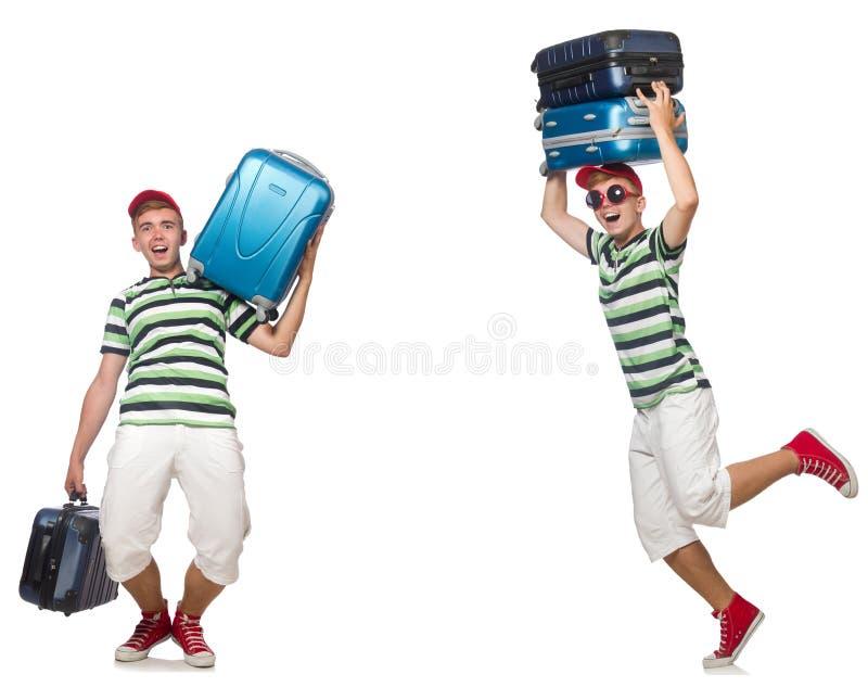Il giovane con le valigie pesanti isolate su bianco immagine stock