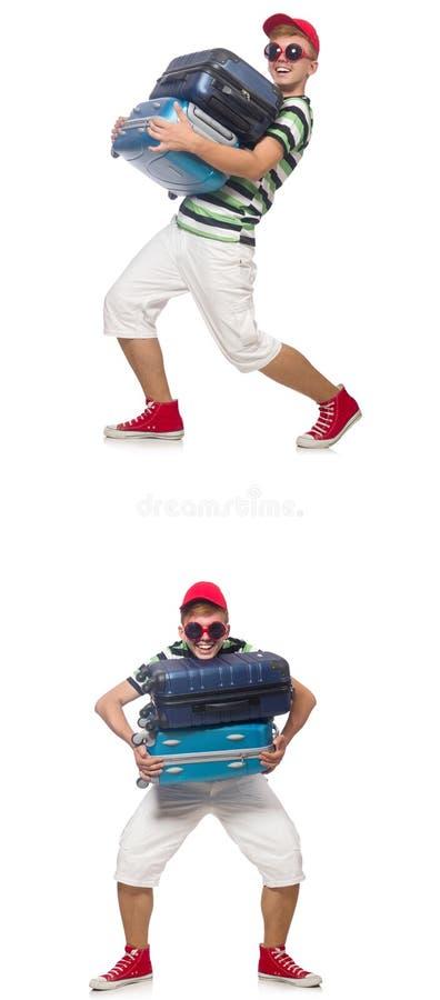 Il giovane con le valigie pesanti isolate su bianco fotografia stock