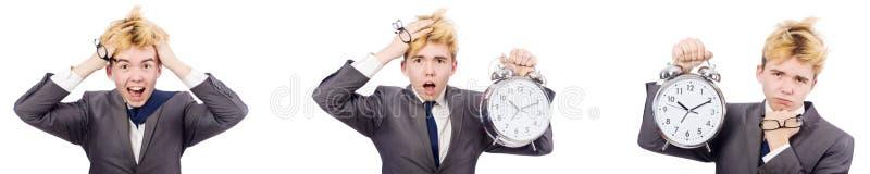 Il giovane ragazzo con la sveglia nel concetto della gestione di tempo immagine stock