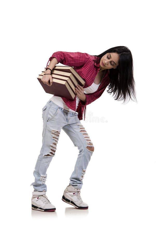 Il giovane studente femminile con i libri isolati su bianco immagini stock
