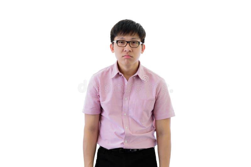 Il giovane uomo d'affari asiatico ha condizione con la depressione che ritiene sull'isolato su sul fondo del wihte fotografia stock libera da diritti