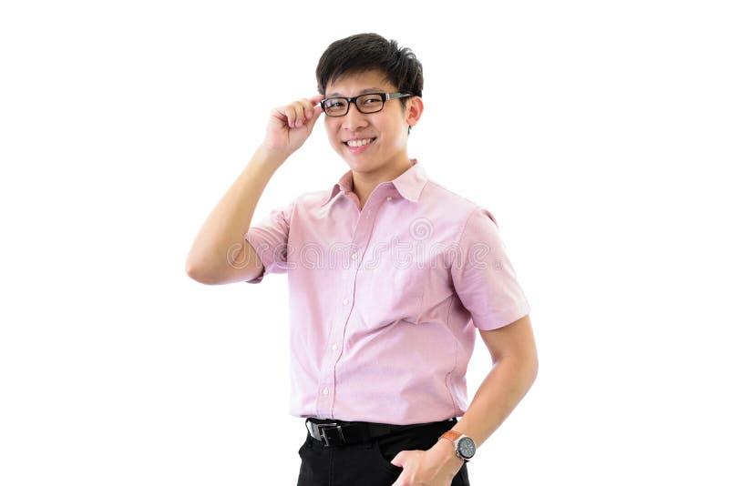 Il giovane uomo d'affari asiatico ha la condizione e pianificazione per lo scopo di affari con felice sull'isolato su sul fondo d immagine stock libera da diritti