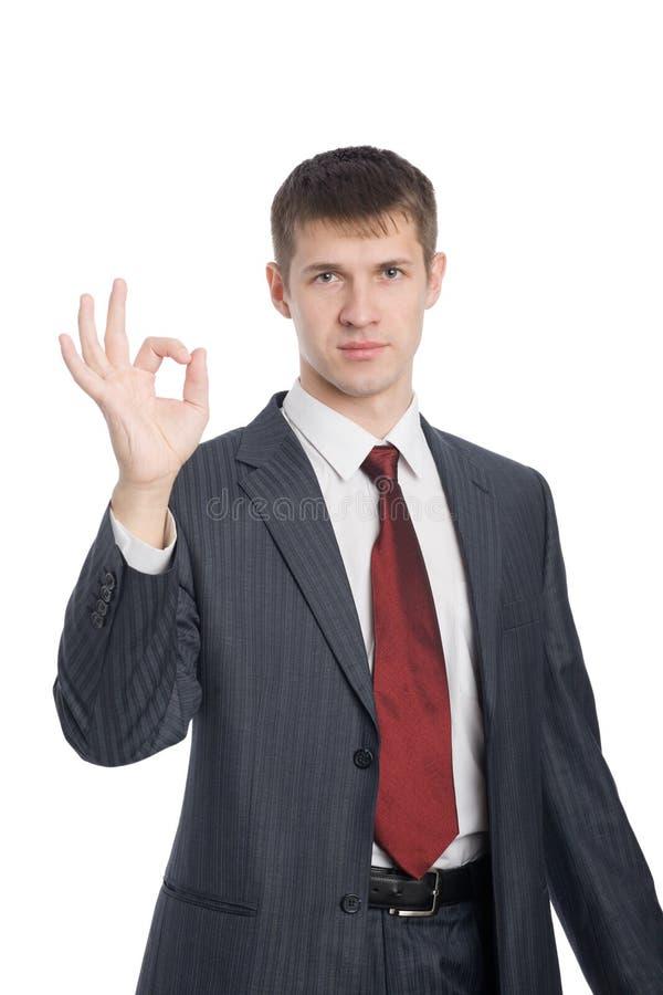 Il giovane uomo d'affari mostra l'approvazione di gesto immagine stock libera da diritti
