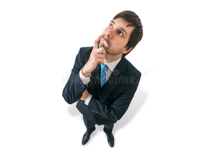 Il giovane uomo d'affari premuroso sta pensando Vista dalla parte superiore fotografie stock