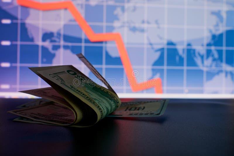 Il grafico di cadute del dollaro e un'istantanea immagini stock