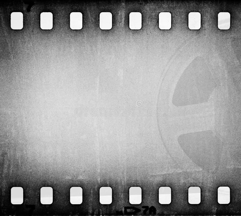 Il gray di lerciume ha graffiato la striscia di pellicola sporca con il fondo della bobina di film illustrazione di stock