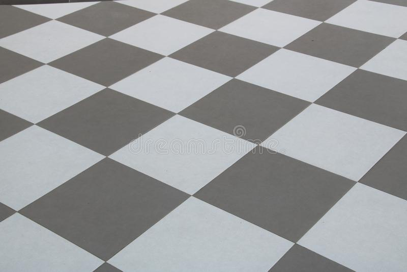 Il gray ed il bianco della tavola delle mattonelle fotografia stock libera da diritti