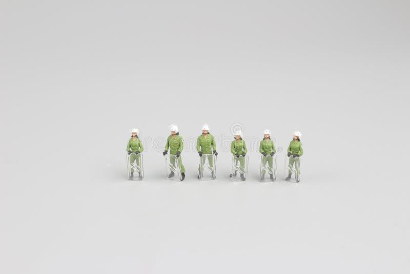 il gruppo di figura polizia al supporto immagine stock libera da diritti