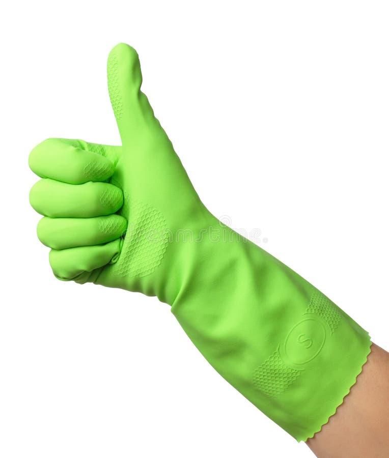 Il guanto di gomma da portare della mano mostra il pollice sul segno fotografie stock