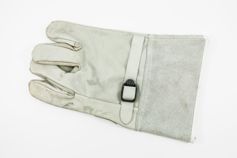 Il guanto grigio per protegge la scossa elettrica fotografie stock libere da diritti
