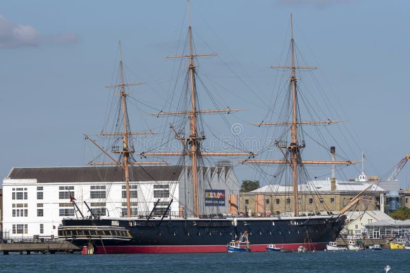 Il guerriero storico di HMS ha ancorato nel porto di Portsmouth, Regno Unito immagine stock libera da diritti
