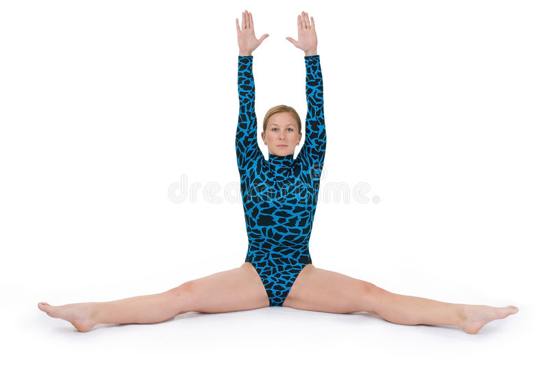 Il Gymnast che fa una spaccatura passa in su fotografia stock