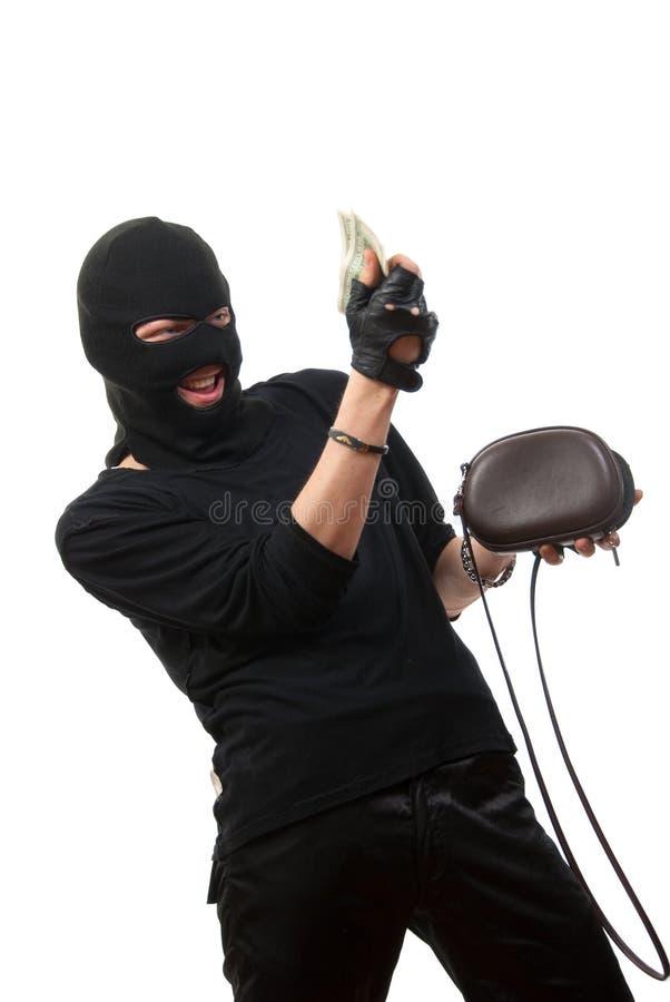 Il ladro felice cattura i soldi dalla borsa rubata. fotografia stock